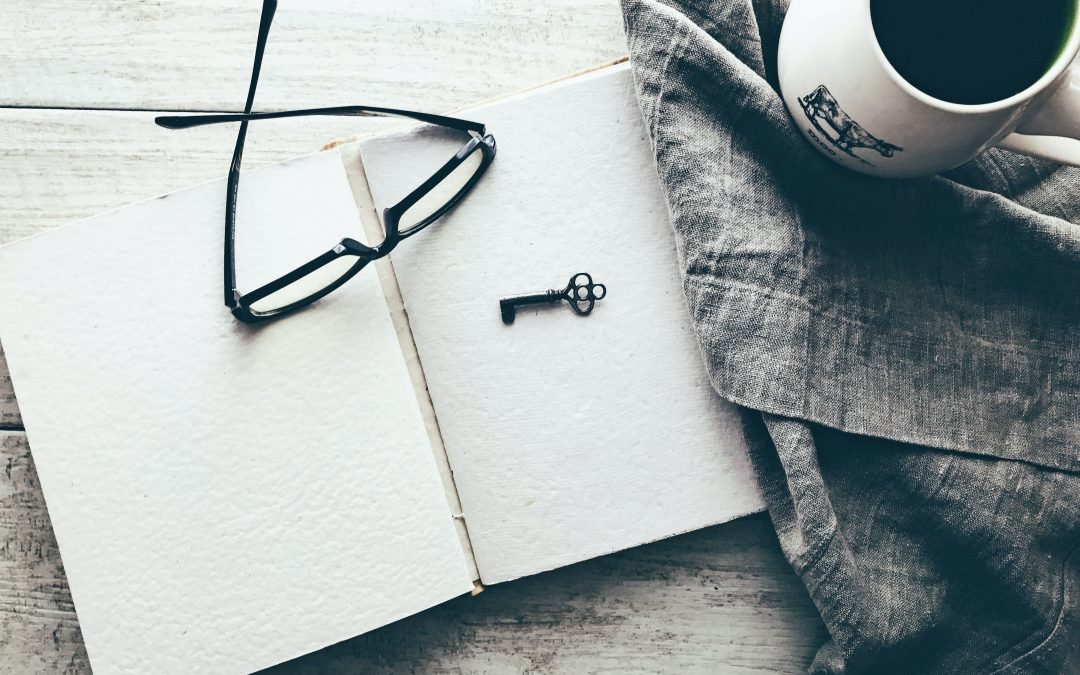 Blank Journal with Glasses and a Key on Top - Business of Creativity